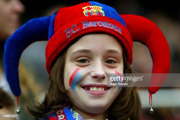 A young Barcelona fan smiles during the La Liga match between FC Barcelona and Mallorca on April 15 played at the Camp Nou stadium in Barcelona Spain