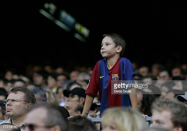 A young Barcelona supporter watches his side beat Atletico de Madrid during the Primera Liga match between Barcelona and Atletico de Madrid at the...