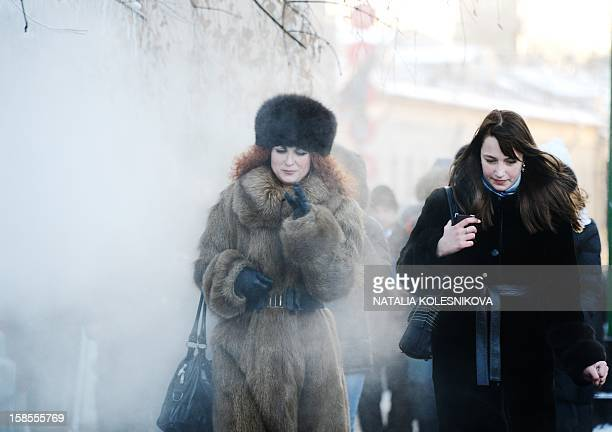 KOLESNIKOVA A young bareheaded woman braves the freezing outdoors in central Moscow on December 19 2012 A cold wave of weather hit this week the...