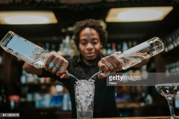 young barista making coctails - mixing stock pictures, royalty-free photos & images