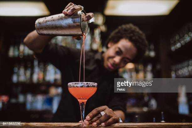 young barista making coctails - cocktail stock pictures, royalty-free photos & images