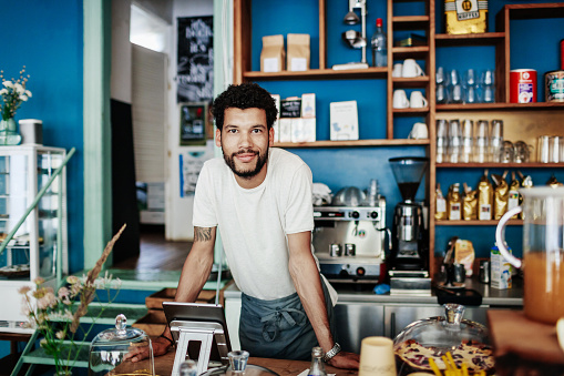 Young Barista Smiling Leaning On Coffee Shop Counter - gettyimageskorea