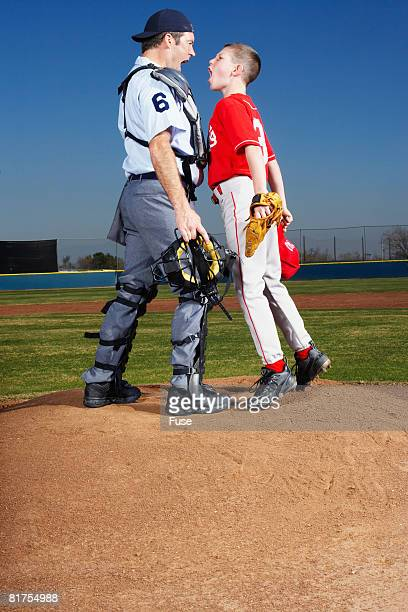 young baseball player arguing with umpire - referee stock pictures, royalty-free photos & images