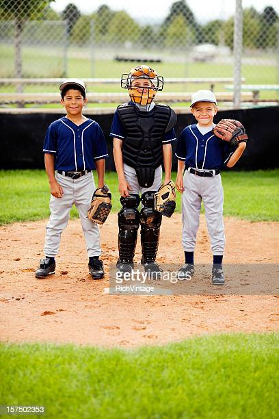 young baseball players - base sports equipment stock pictures, royalty-free photos & images
