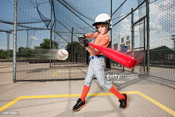 young baseball swing in batting cage - basebollslag bildbanksfoton och bilder