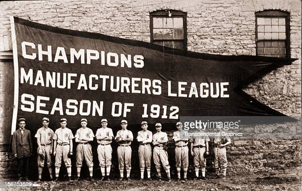A young baseball team poses before their enormous championship banner in 1912 in an unknown north american location