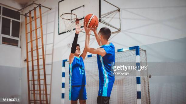 Young basketball player going for the point