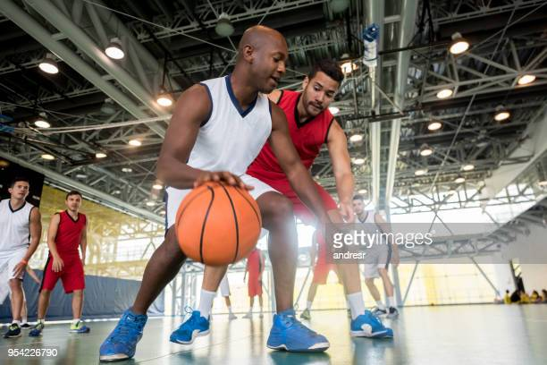 young basketball players at a game - basketball team stock pictures, royalty-free photos & images