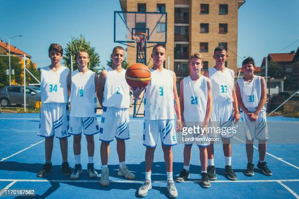 young basketball team outdoor - basketball team stock pictures, royalty-free photos & images