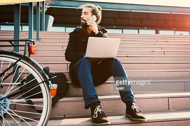 Young Beard Businessman Using Smart Phone.