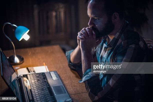 Young bearded man checking his bank account online