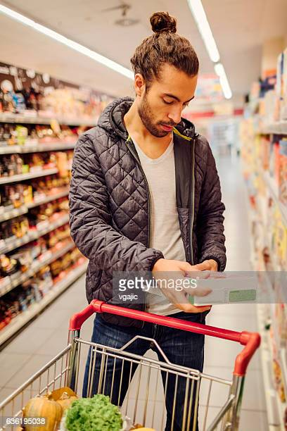 Young Bearded Man In A Supermarket.