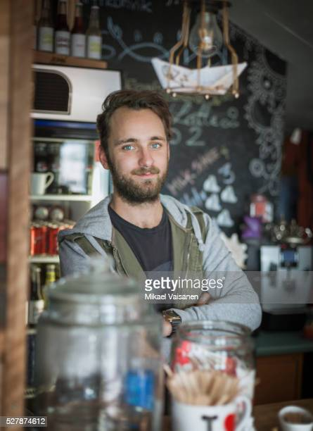 Young bearded man in beach cafe
