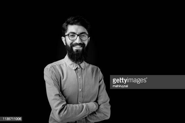 young bearded man portrait - black and white stock pictures, royalty-free photos & images