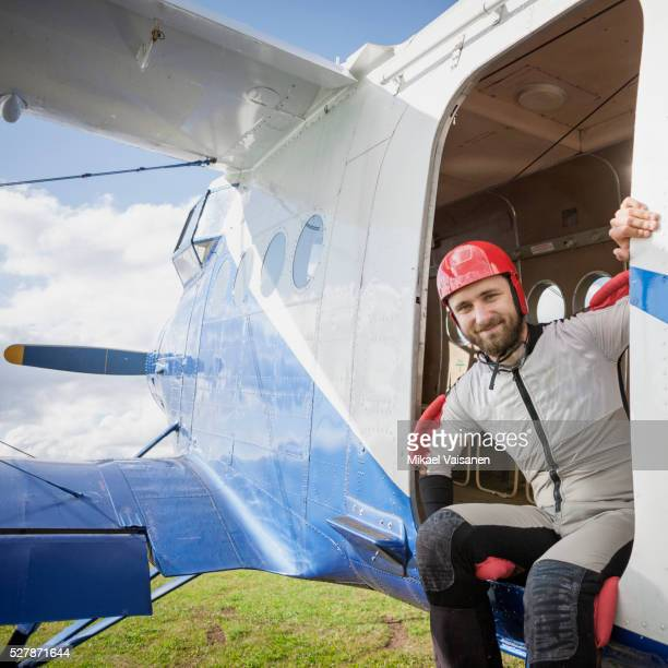 Young bearded man preparing to skydive