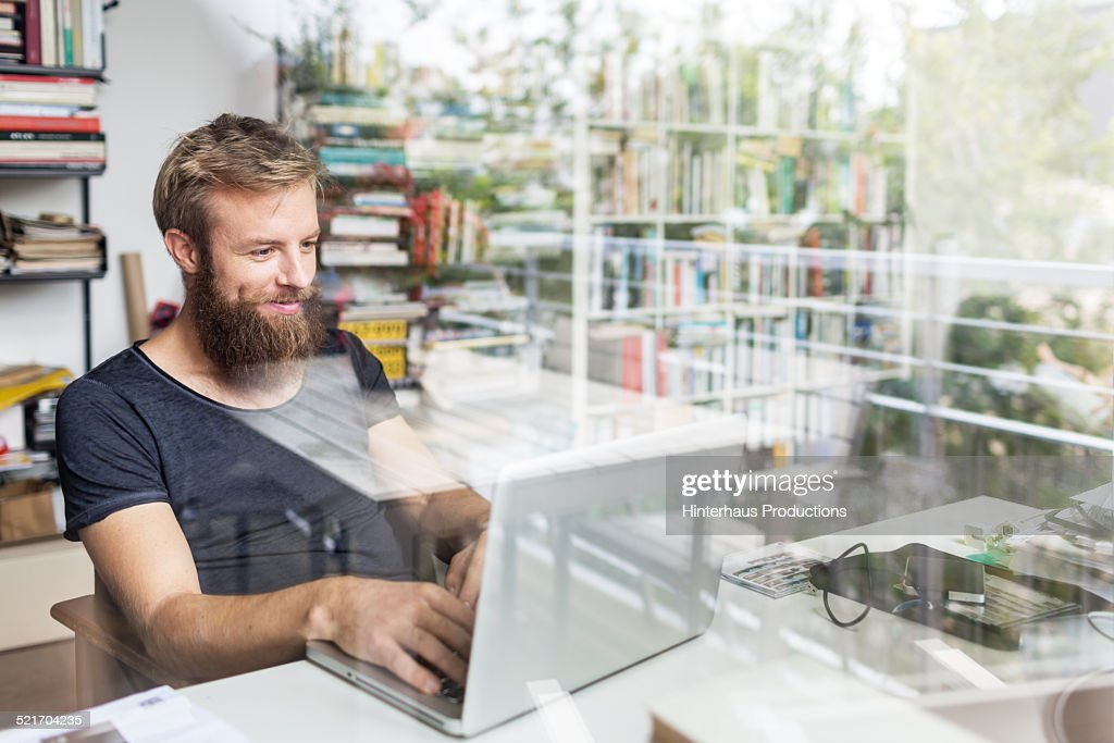 Young Bearded Man Working At Home Office : Stock Photo