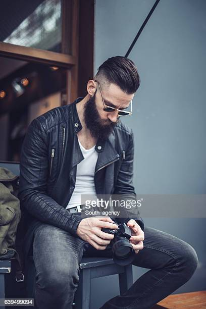 young bearded photographer - biker jacket stock pictures, royalty-free photos & images