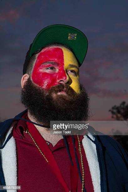 young bearded sports fanatic man in facepaint - jason todd stock photos and pictures