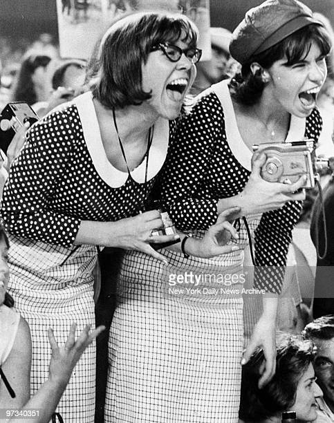 Young Beatles fans let loose with shrieks during concert at Shea Stadium. Beatles played to a packed house of 55,000 fans, some of whom used police...