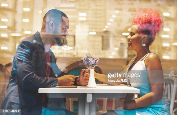 young beautiful afro couple having romantic dinner - written date stock pictures, royalty-free photos & images