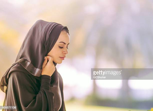young beautiful arab girl covering her head - beautiful arab girl stock photos and pictures