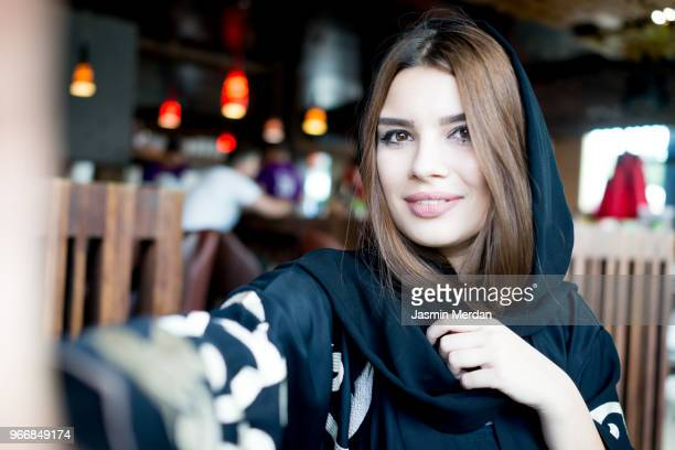 young beautiful arabic woman taking a selfie - one young woman only stock pictures, royalty-free photos & images