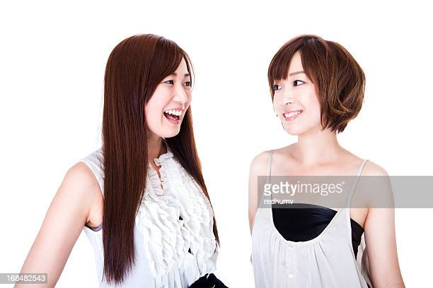 young beautiful asian women talking - beautiful japanese girls stock photos and pictures