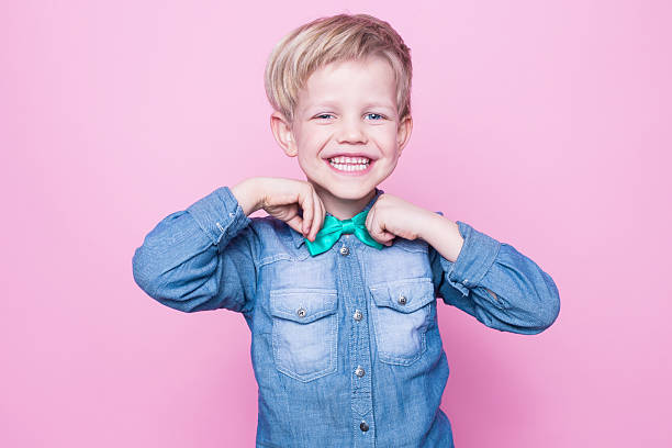 Young Beautiful Boy With Blue Shirt And Butterfly Tie