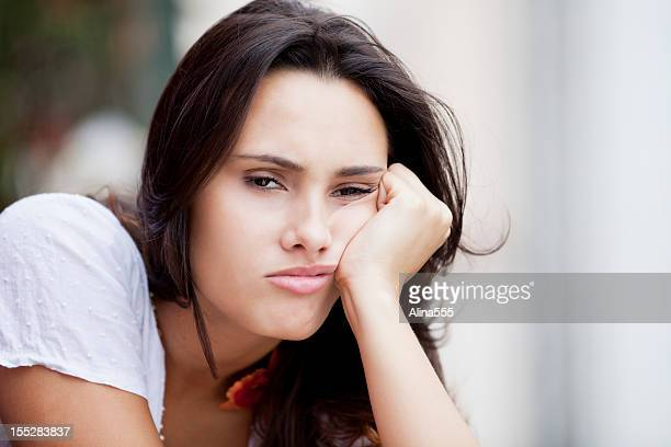 Young Beautiful brazilian woman with bored empty expression