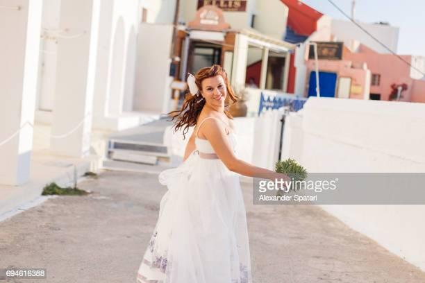 Young beautiful bride in Santorini, Greece