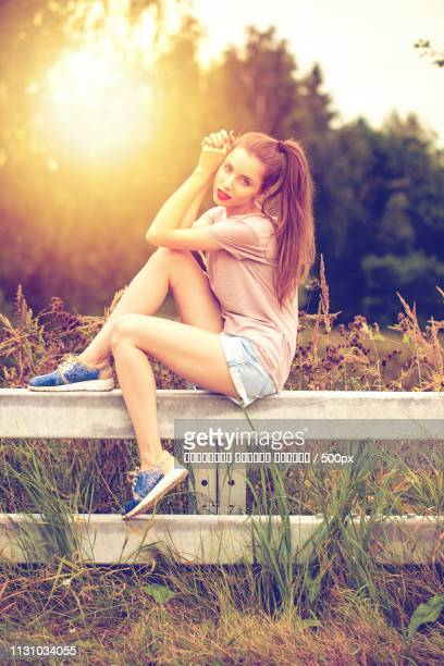 Young Beautiful Brown Haired Woman In Blue Jeans