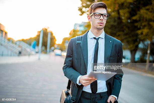 Young beautiful businessman outdoors