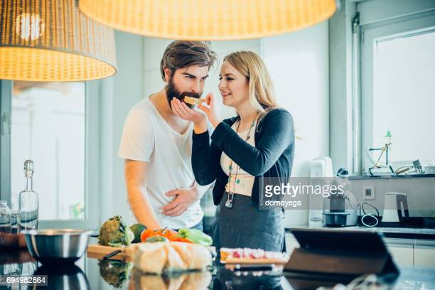 Young beautiful couple having diner in the kitchen