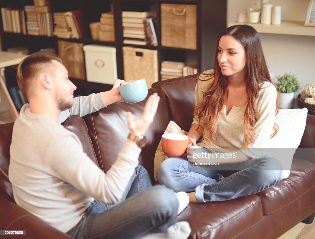 Young beautiful couple in home interior : Stockfoto