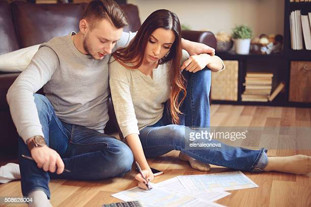 Young beautiful couple in home interior