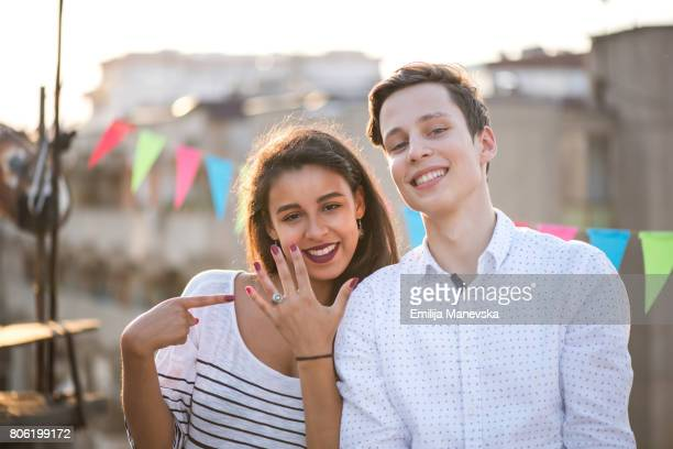 young beautiful couple making selfie with the engagement ring - black women engagement rings stock pictures, royalty-free photos & images