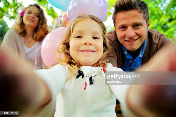young beautiful family taking selfie - beautiful turkish girl stock pictures, royalty-free photos & images