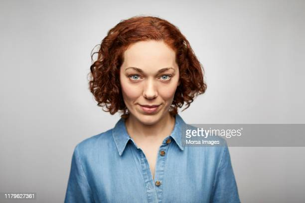 young beautiful female ceo wearing denim shirt - femme rousse photos et images de collection