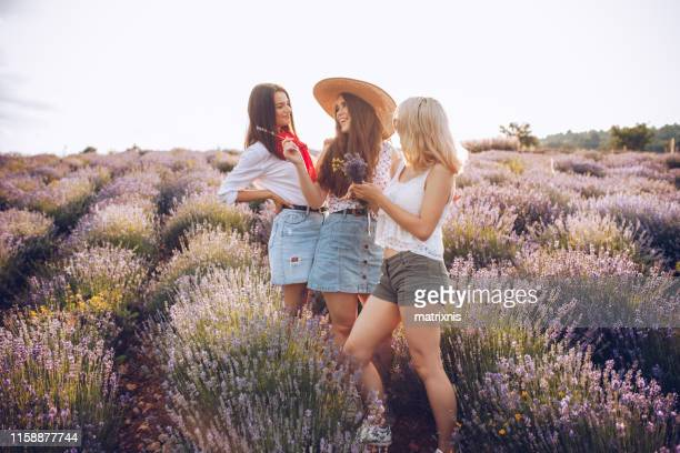 Young beautiful females picking the best flowers