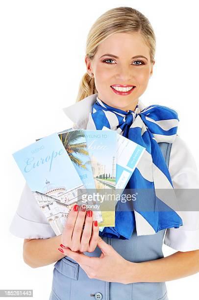 Young beautiful flight attendant showing catalogs