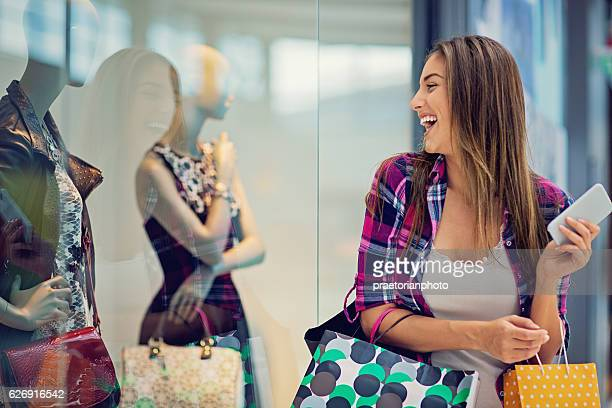 Young beautiful girl is shopping in the Mall