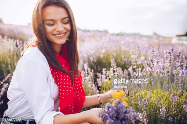 Young beautiful happy female in the lavender field