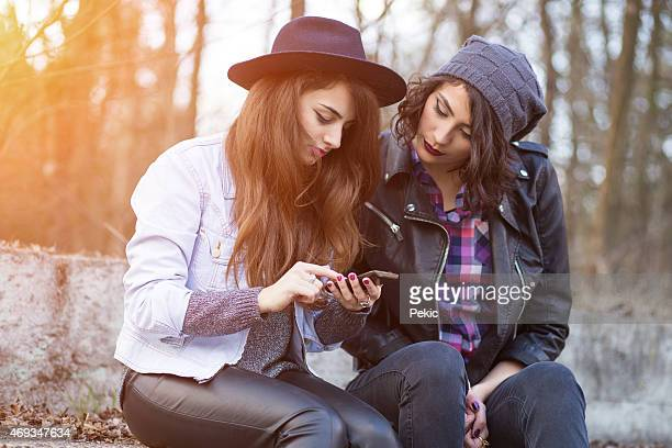 Young beautiful hipster women using smart phone