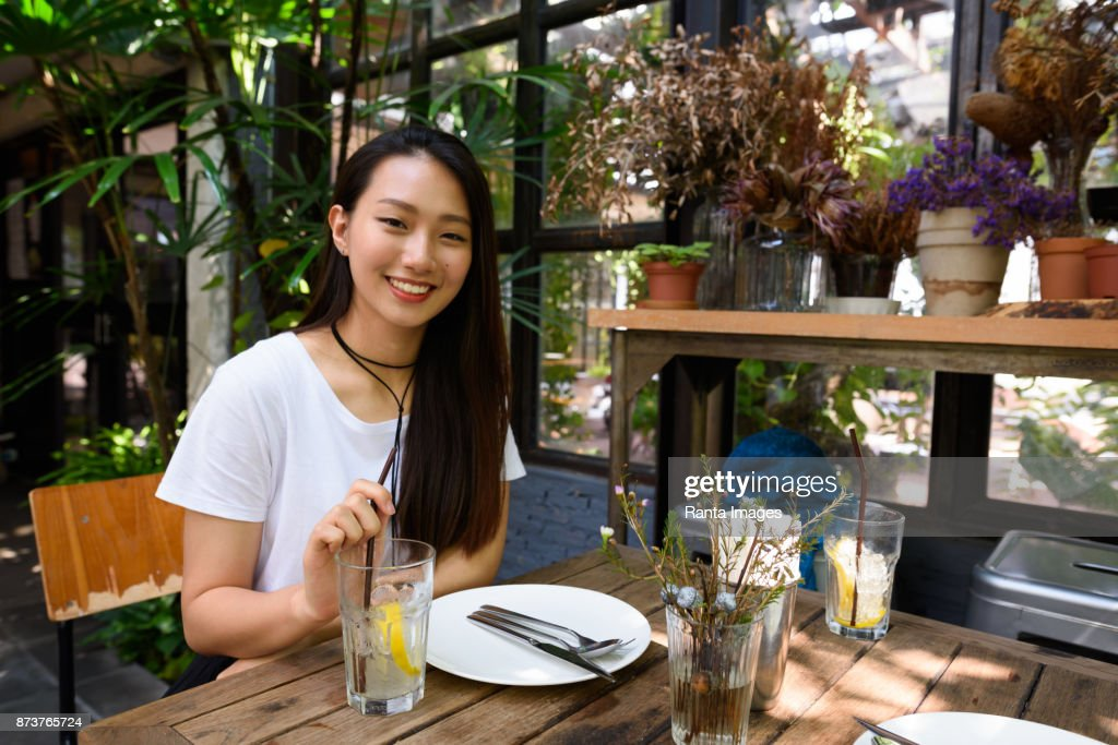 Young Beautiful Korean Woman Relaxing At Outdoor Restaurant High Res Stock Photo Getty Images