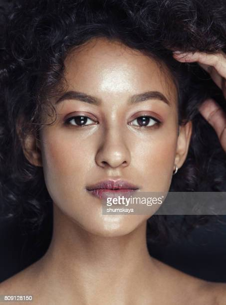 young beautiful model with curly hair and fresh make-up - light brown eyes stock photos and pictures