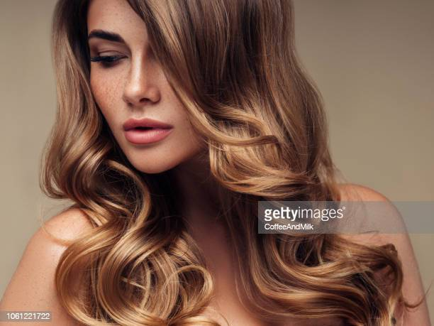 young beautiful model with long wavy well groomed hair - curly stock pictures, royalty-free photos & images