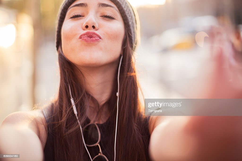 Young beautiful spanish woman in the streets of Barcelona. : Stock Photo