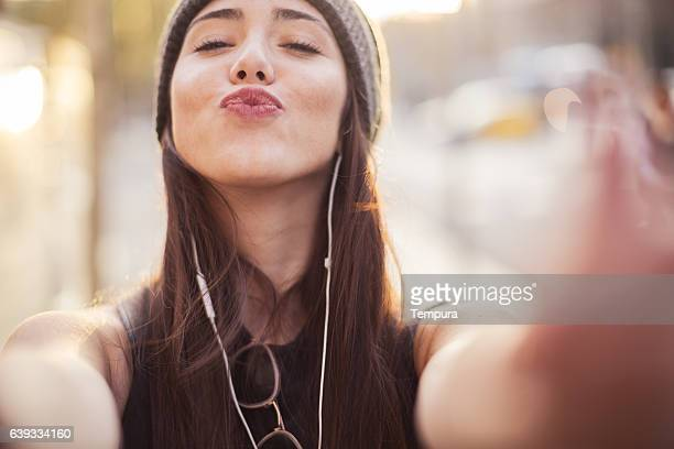 young beautiful spanish woman in the streets of barcelona. - city photos stock pictures, royalty-free photos & images