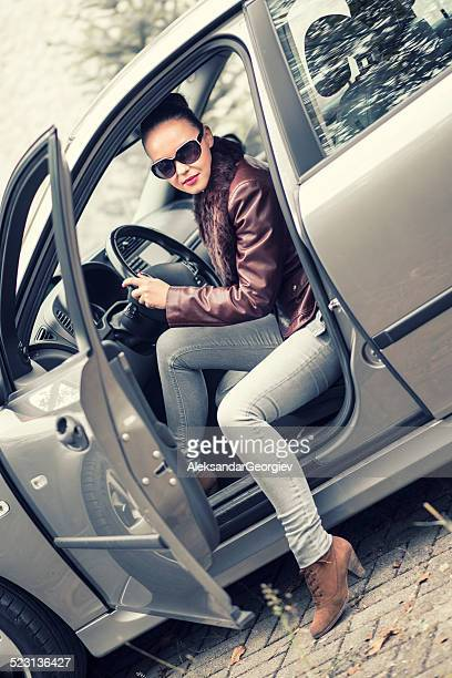Young Beautiful Stylish Women Getting Out of Car