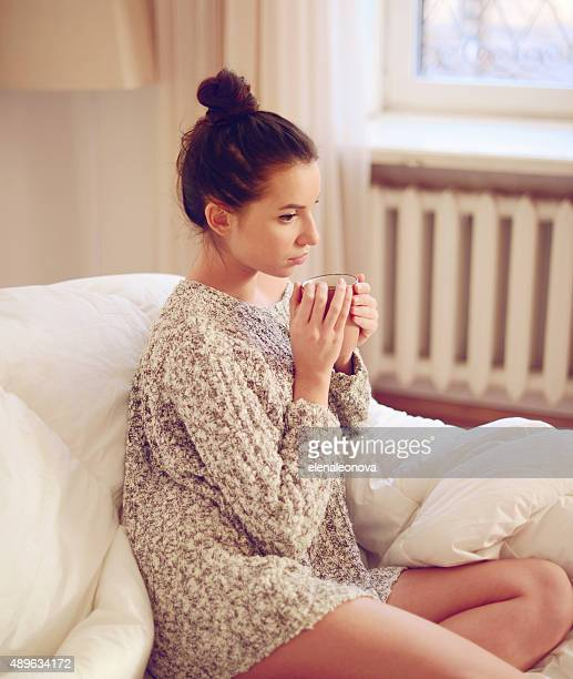 young beautiful woman drinking hot coffee
